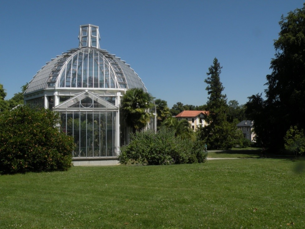 "Temperate greenhouse, Herbarium ""La Console"" and the house for school activities (from left to right)"